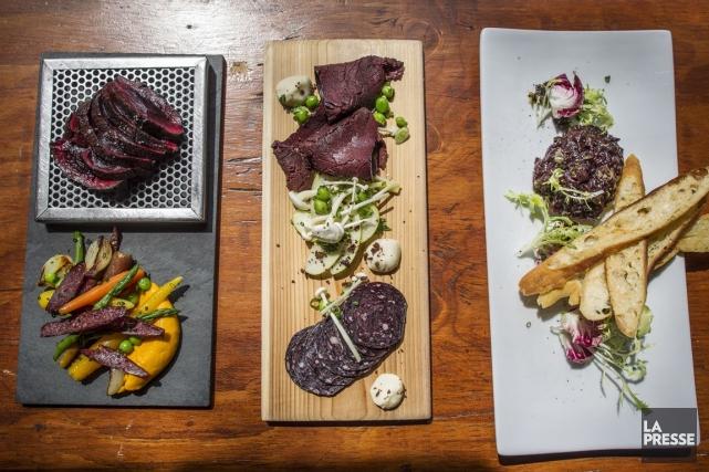Quelques plats de viande de loup marin préparés... (PHOTO OLIVIER PONTBRIAND, LA PRESSE)
