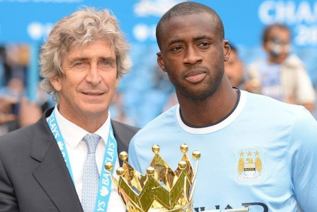Le directeur de Manchester City Emanuel Pellegrini et... (Photo Nigel Roddis, archives Reuters)