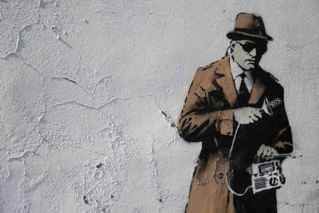 Un graffiti de Banksy, à Cheltenham en Angleterre.... (Photo Eddie Keogh, Reuters)