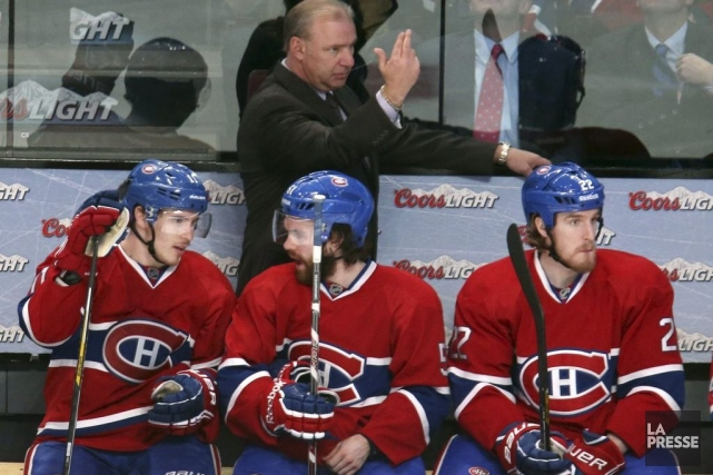 Michel Therrien derrière Brendan Gallagher, David Desharnais et... (Photo Jean-Yves Ahern, USA Today)
