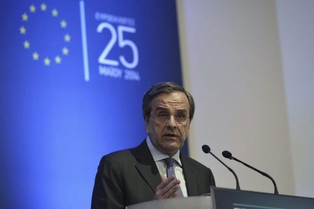Antonis Samaras a assuré que 770000 emplois nouveaux... (PHOTO LOUISA GOULIAMAKI, AFP)