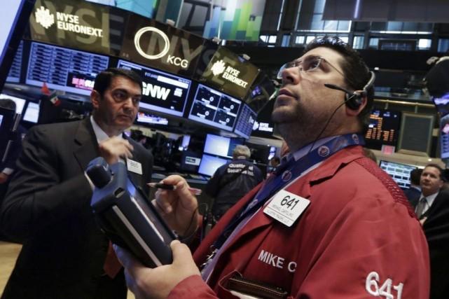 Après une séance dominée par l'aversion au risque,... (Photo Richard Drew, AP)