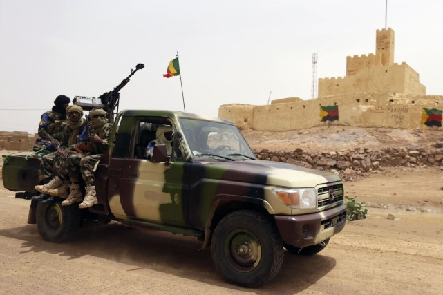 Des soldats maliens... (Photo KENZO TRIBOUILLARD, AFP)