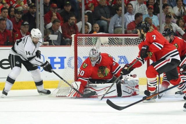 Le gardien des Blackhawks Corey Crawford arrête un... (Photo Dennis Wierzbicki, USA Today)