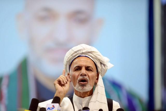 À la tribune, Ashraf Ghani s'est lancé dans... (PHOTO SHAH MARAI, AFP)