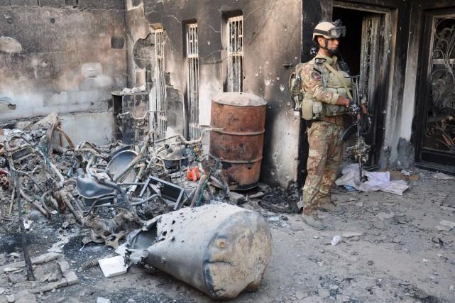 Au moins 10 personnes ont été tuées et plusieurs dizaines blessées jeudi dans... (Photo AZHAR SHALLAL, AFP)