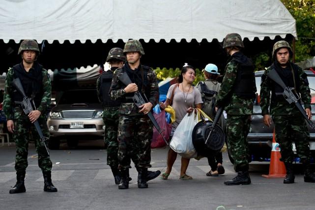 Une femme qui faisait parti du camp où... (Photo Manan Vatyayana, AFP)