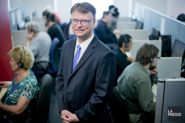 Jean-Marc Léger, PDG de Léger, dans le centre... (Photo David Boily, La Presse)