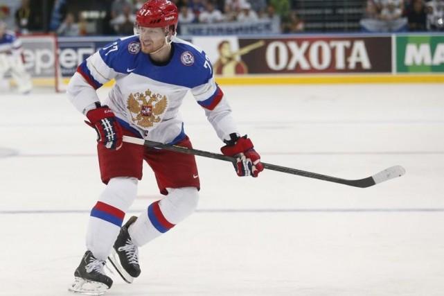 Le défenseur Anton Belov a marqué le troisième... (Photo Darko Bandic, AP)