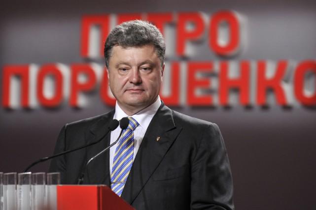 Un travail titanesque attend le futur président,Petro Porochenko,qui... (Photo: AP)