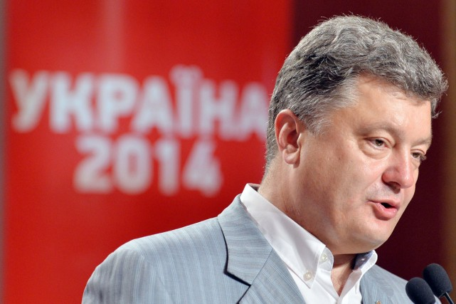 Petro Porochenko a recueilli plus de 54 % des suffrages... (PHOTO SERGEI SUPINSKY, AFP)