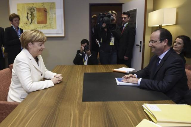 La chancelière allemande Angela Merkel et le président... (Photo JOHN THYS, AFP)