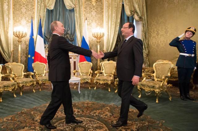 François Hollande a été accueilli à Moscou par... (Archives AFP)