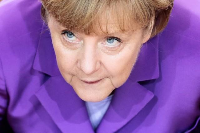 C'est la quatrième fois consécutive qu'Angela Merkel s'impose... (PHOTO MARKUS SCHREIBER, AP)
