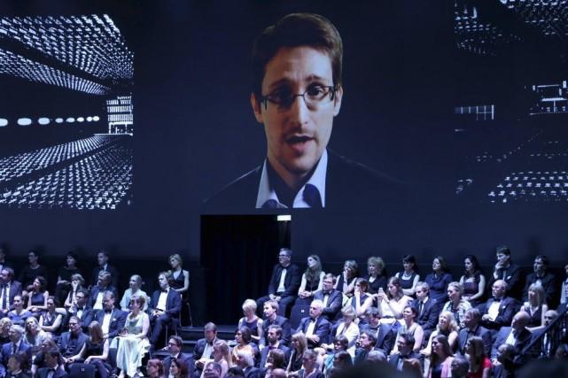 Edward Snowden affirme n'avoir jamais voulu se réfugier... (PHOTO AXEL HEIMKEN, AFP)