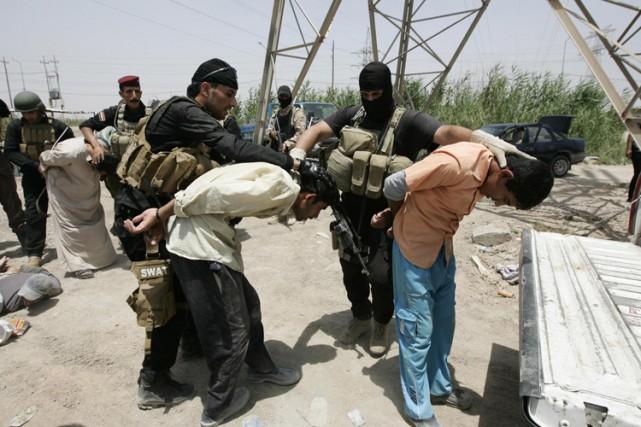 Des forces de sécurité irakiennes ont appréhendé des... (Photo: Reuters)