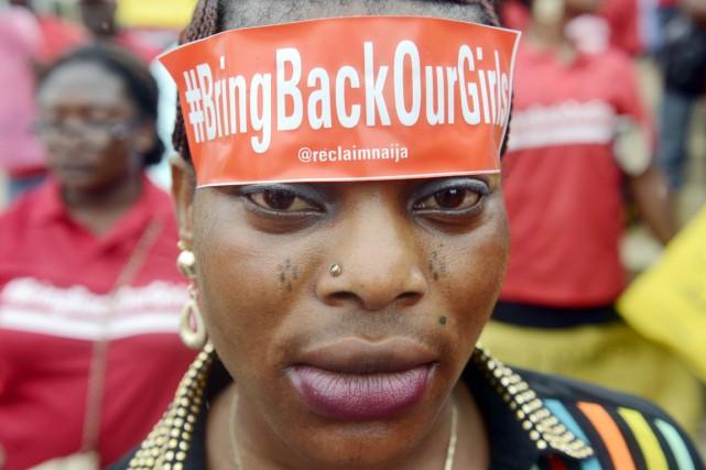 Une manifestation pour la libération des plus de... (PHOTO PIUS UTOMI EKPEI, AFP)