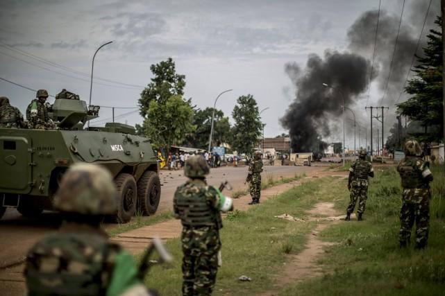 Des forces de maintien de la paix en... (Phtoo Marco Longari, AFP)