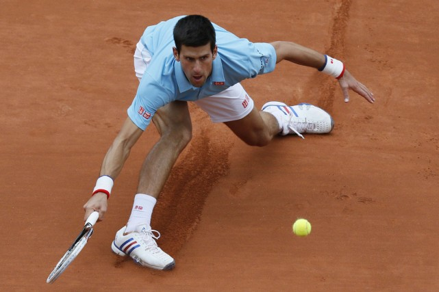 Le deuxième joueur mondial Novak Djokovic a défait... (Photo Patrick Kovarik, AFP)