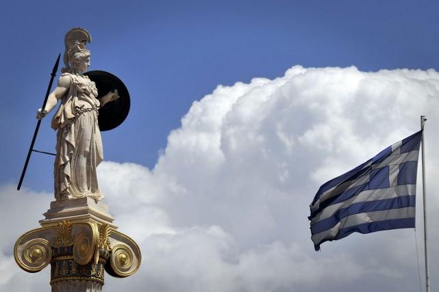En récession depuis six ans, le pays table... (PHOTO LOUISA GOULIAMAKI, ARCHIVES AFP)