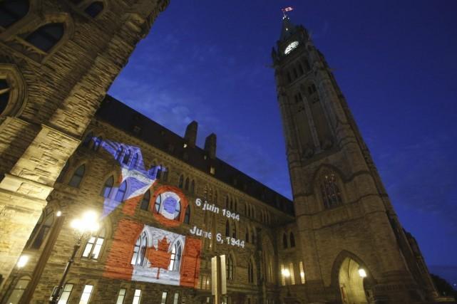 Le message«Merci le Canada, thank you Canada»sur la... (PHOTO PATRICK DOYLE, AFP)