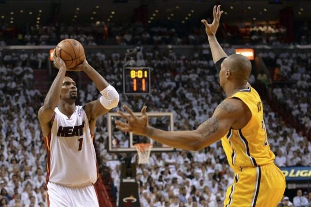 LeBron James et Chris Bosh (photo, à gauche)... (Photo USA TODAY Sports)