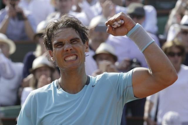 Rafael Nadala atteint les huitièmes de finale à... (PHOTO KENZO TRIBOUILLARD, AFP)