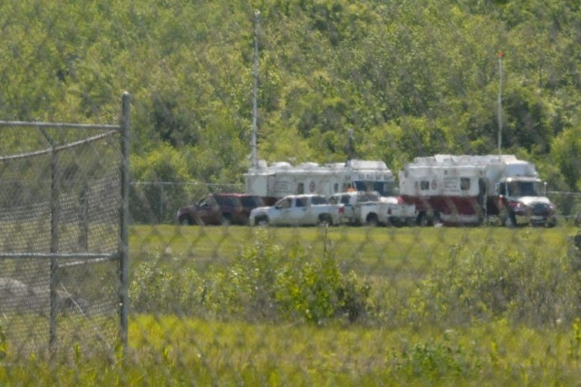 Les services d'urgence de l'aéroport Hanscom Field étaient... (PHOTO NEAL HAMBERG, REUTERS)