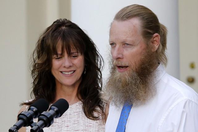 Accompagné de sa femme Jani, le père de... (PHOTO ARCHIVES REUTERS)