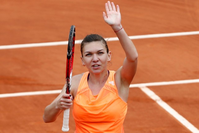 Simona Halep... (Photo Darko Vojinovic, AP)