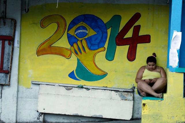 Les touristes qui arrivent à Rio de Janeiro pour la Coupe du monde en pensant... (PHOTO PILAR OLIVARES, ARCHIVES REUTERS)