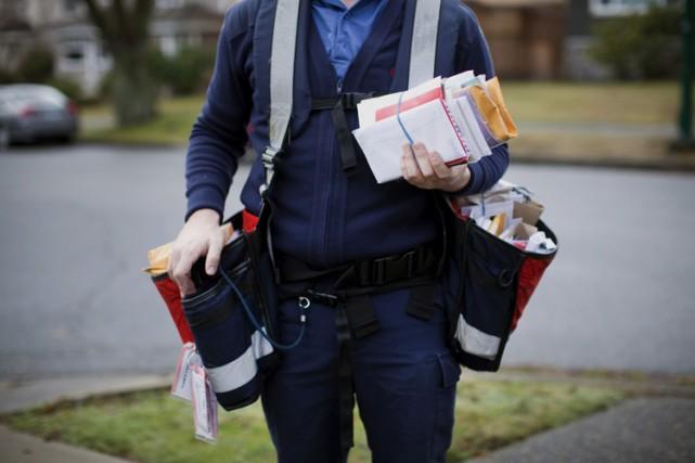 Le NPD pourrait être obligé de rembourser les envois postaux effectués par... (Archives Bloomberg)