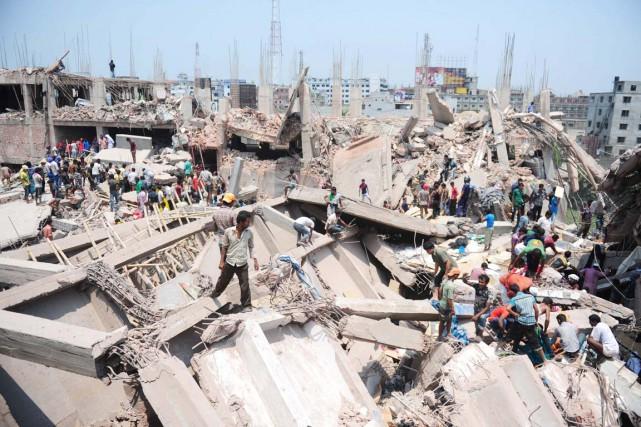 2013 - L'effondrement d'un immeuble servant à la confection textile fait plus... (PHOTO MUNIR UZ ZAMAN, ARCHIVES AFP)