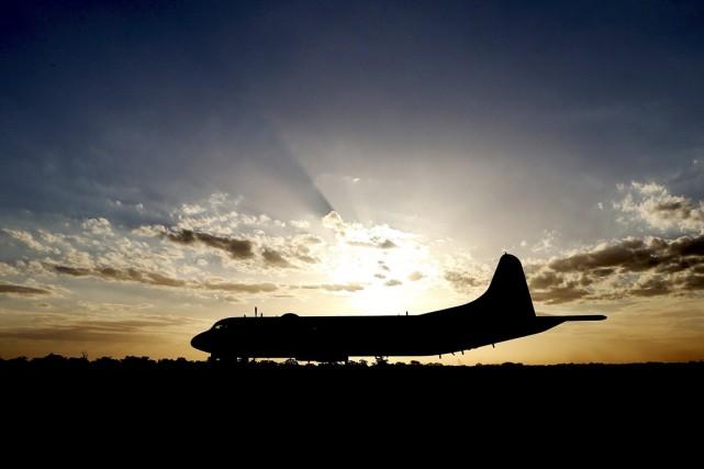 Le Boeing777, qui effectuait la liaison Kuala-Lumpur/Pékin avec... (PHOTO  ROB GRIFFITH, ARCHIVES AFP)