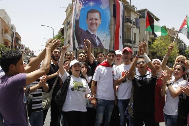 Bachar al-Assad a remporté sans surprise la présidentielle en Syrie, présentant... (Photo: AFP)