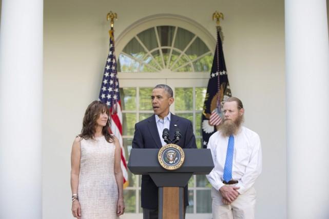 Le président Obama, accompagné de Jani et de... (PHOTO CAROLYN KASTER, ARCHIVES AP)