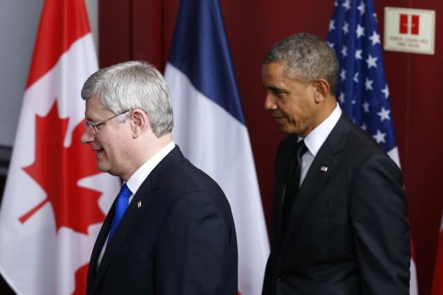 Le premier ministre canadien Stephen Harper accompagné du... (Photo d'archives)