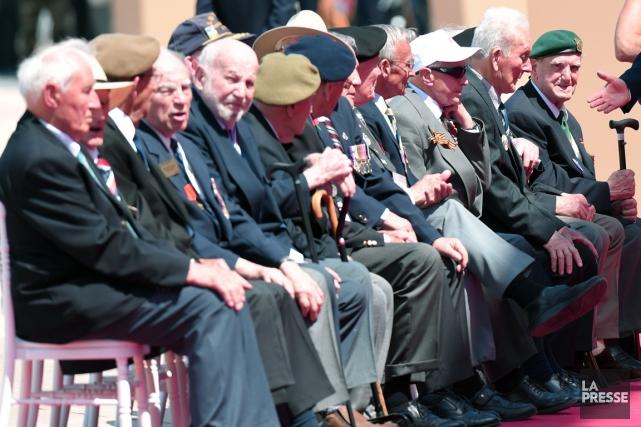Des anciens combattants ont assisté à la cérémonie... (AFP)