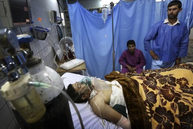 Un homme blessé lors de l'explosion d'unevoiture piégéerepose... (SAFIN HAMED)