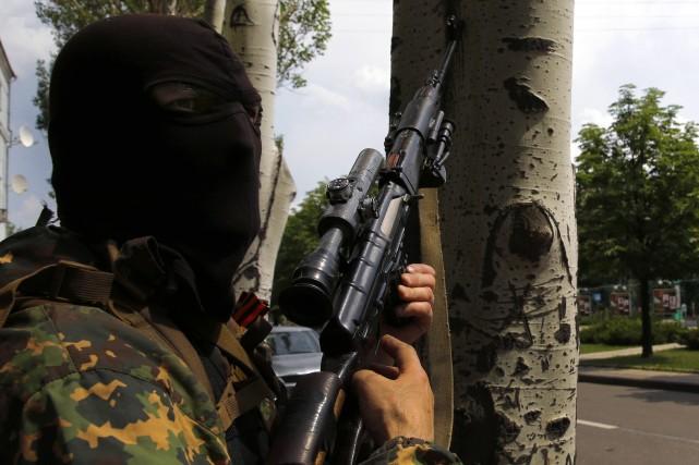 Les séparatistes prorusses ont attaqué samedi soir et dimanche matin l'aéroport... (Photo YANNIS BEHRAKIS, Reuters)