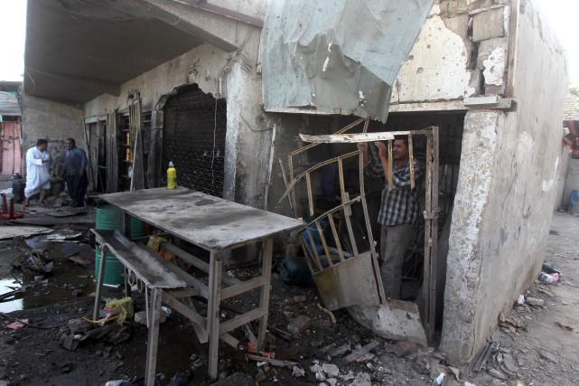 Au moins 26 personnes sont mortes dimanche en Irak, dont 17 dans un double... (Photo AHMAD AL-RUBAYE, AFP)