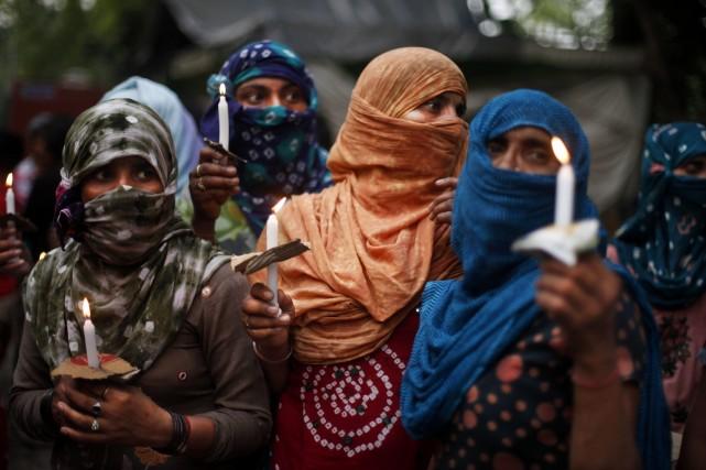 Une manifestation contre les viols collectifs en Inde... (Photo Altaf Qadri, AP)