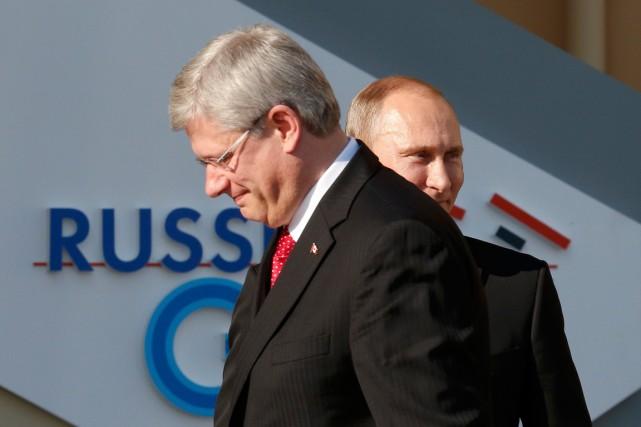 Le premier ministre Harper et le président Poutine... (PHOTO GRIGORY DUKOR, ARCHIVES REUTERS)
