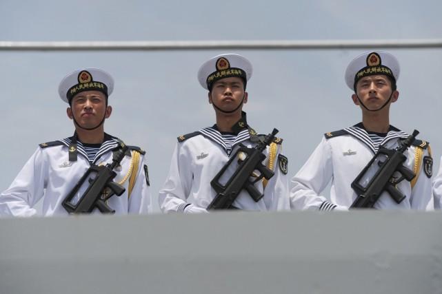 Deuxième puissance militaire au monde après les États-Unis,... (PHOTO SOE THAN WIN, ARCHIVES AFP)