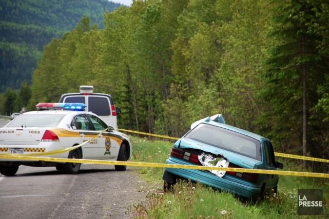 La voiture dans laquelle gisaient les deux corps... (Photo Collaboration spéciale Johanne Fournier)