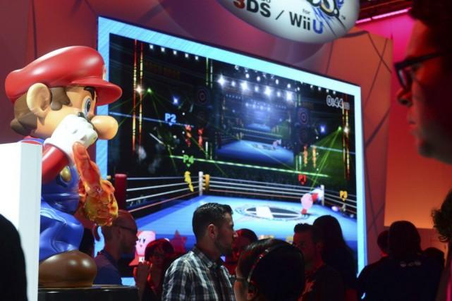 L'action du pionnier japonais des jeux vidéo Nintendo s'est envolée de 21%... (PHOTO FREDERIC J. BROWN, AFP)