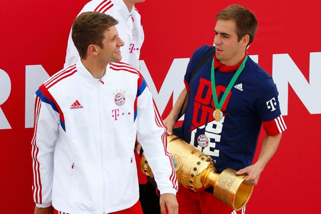 Thomas Müller et Philipp Lahm, du Bayern Munich.... (Photo Michael Dalder, Reuters)