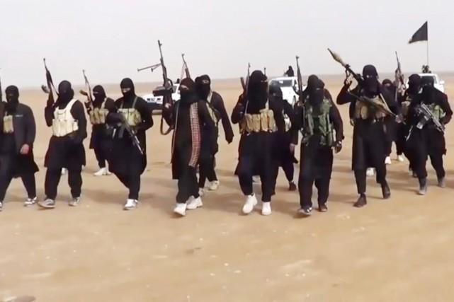 Des militants de l'État islamique en Irak et... (PHOTO ARCHIVES AFP/EIIL)