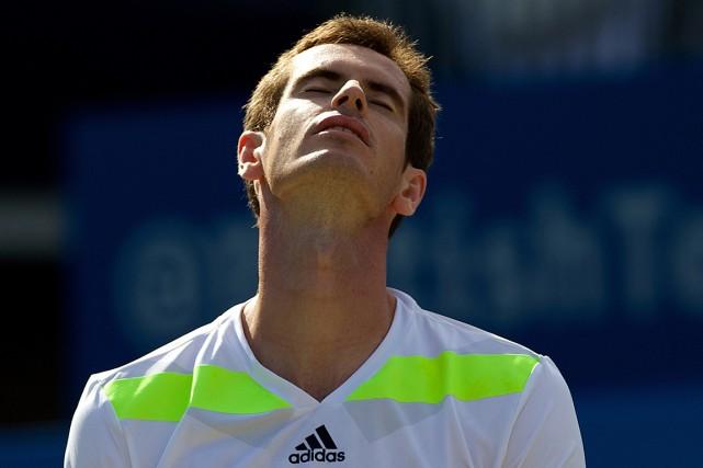 Le tenant du titre Andy Murray a été... (Photo Andrew Cowie, AFP)