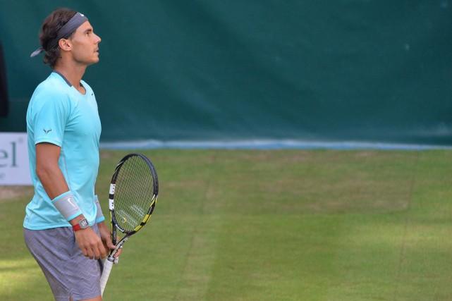 Rafael Nadal n'a pas gagné sur gazon depuis... (Photo Carmen Jaspersen, AFP)